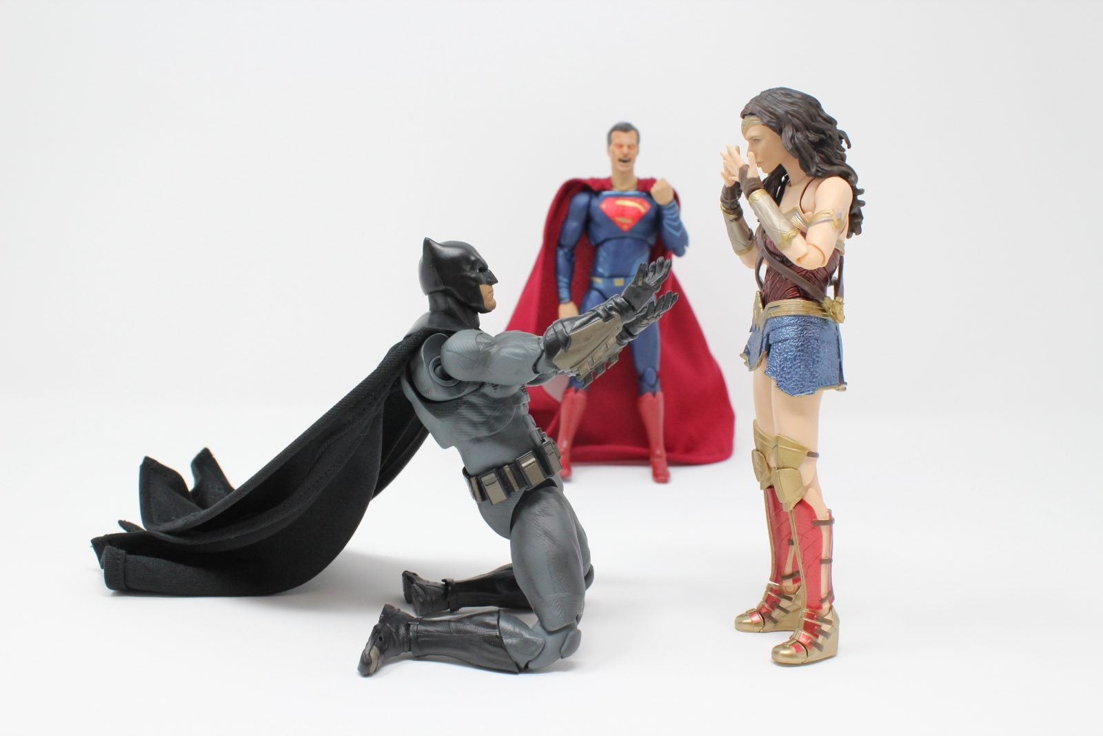 Superman, Batman, and Wonder Woman action figures