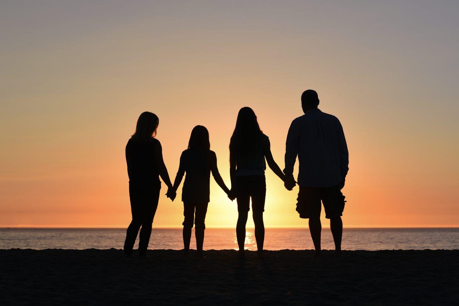 four people on seashore